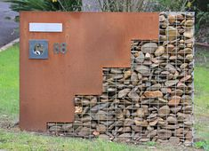 gabion and corten, great combo. This river rock gabion and corten steel for house numbers and mail is in Melbourne, Australia. Photo by Virginia Blue.
