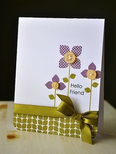 Stamped a few stems using the stem images from Green Thumb. Topped two stems with the solid leaf trio image, in Plum Pudding. Stamped the polka dot square four times, also in Plum Pudding, to create the larger flower.  Embellished the flower centers with Harvest Gold buttons and white embroidery floss. Stamped a few leaves using the smallest square and a sentiment, both included in Modern Basics. At the base of the card I used a border image from Modern Basics.