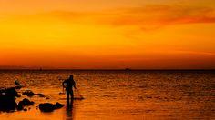 Fisher man, via Flickr. | #earthtones #brown #gold #orange #ocean #silhouette