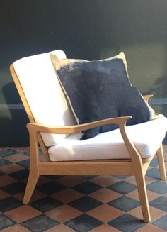 Oak Scandi-style chair with white cushions