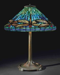 TIFFANY STUDIOS -  A 'DRAGONFLY' LEADED GLASS AND BRONZE TABLE LAMP, CIRCA 1910.