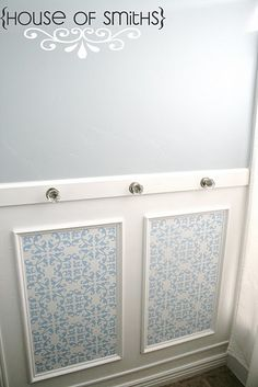 Vintage knobs for towel hooks on the wainscoting. Genius! Off to ebay to find some knobs...
