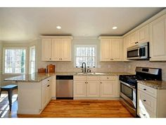 Nice kitchen, white cabinets, stainless steel appliances