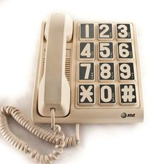 VINTAGE PHONE WITH BIG SHOUTY NUMBERS