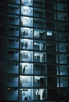 1962: People stand on their balconies in the night air, Singapore Winfield…