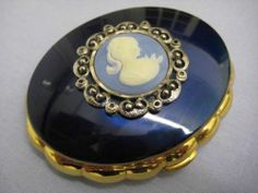 STUNNING VINTAGE BRASS AND ENAMEL KIGU MUSICAL POWDER COMPACT