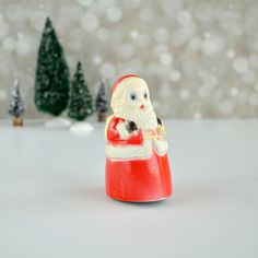 Plastic Santa friction toy by Fun World; Santa figurine by TheGoldGator on Etsy