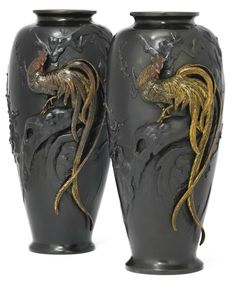 A Pair of Bronze Vases  Signed Seiya saku, Meiji Period (late 19th century)  Boldly carved, undercut and inlaid in silver and gilt with longtailed cockerels in high relief in branches with plum blossom, their combs in red, the vases with a rich dark brown patination