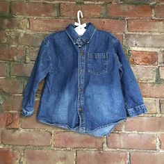 Old Navy toddler size 4 denim shirt. Old Navy toddler size 4 denim shirt. Distressed on lower bottom. Purchased this way. Very cute. No marks, stains or signs of wear. Old Navy Tops Button Down Shirts