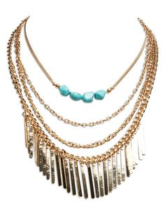 """<p>Fringe and faux turquoise are two of our favorite things, so <em>obviously </em>we're totally obsessed with this layered necklace! It features a four-tier multi-chain design with shiny metal paddle fringe and faux turquoise stone bead details. It's perfect for adding a touch of boho shine to an airy maxi dress or basic tee!</p> <ul> <li>Lobster Clasp Closure</li> <li>20"""" Length / 1"""" Drop</li> <li>Metal / Man Made Materials</li> <li>Imported</li> </ul>"""