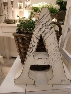 Modpodge a copy of your marriage certificate, or a birth certificate onto your wooden initial.