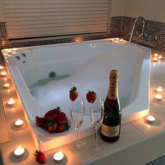 Date night! Romantic bubble bath with candles, rose petals and champagne Date night! Romantic bubble bath with candles, rose petals and champagne