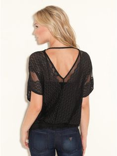 The solution to v-neck tops that want to fall off -- a single strap across the top of the back. Lacy sheer top in black.
