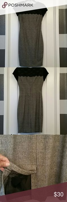 Dress Beautiful NWOT Zara dress! This dress is truly beautifully made. I never wore it! The pattern is gorgeous and the lace on the top add sophistication to this piece. Zara Dresses Midi