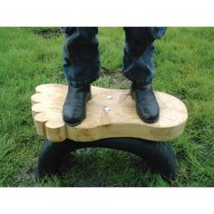 A thick, foot-shaped playground balance board set onto a rubber tyre. The Wobble Foot Playground Balance Board is not just a fun piece of equipment, it also helps children to exercise and aids the development of balance skills.