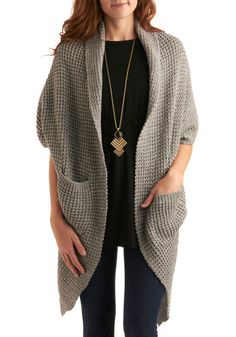 """ModCloth """"Talk of the Town"""" cardigan. I'm afraid of chunky knits, but might be able to pull this off. It looks like a giant pashmina with pockets."""