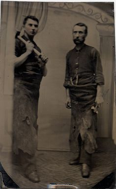 Two Blacksmiths - Occupational Tintype/  The leather aprons and heavy hammers held by the two men suggest that their work requires heavy protection and tools. I have always thought of them as blacksmiths. The focus in the tintype is somewhat soft and the pink tinting on the cheeks seems a bit incongruous.