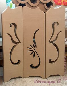 folding screen. If larger can be room divider. Would be lovely if made from cardboard