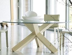 round glass top dining table with wooden legs