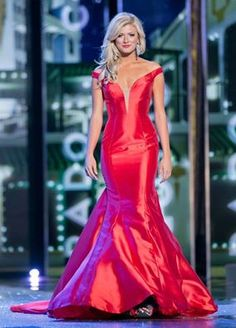 """Miss Colorado 2015 Kelley Johnson captivated the crowd and the TV audience with her touching story during the talent portion. Her evening gown presentation was just as impactful as her height and beauty were evident.  The Color  It appears that silk taffeta is the """"it"""" fabric of the upcoming season. Kelley's red evening gown features hues of fuchsia and even deep cranberry.  She opted for a red lip to tie the design together and add extra drama to the overall presentation."""