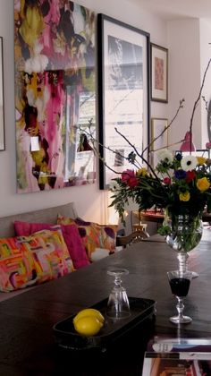 Colorful art and pillows liven up this space