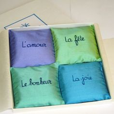 French Lavender Sachets Gift set. French calligraphy . Aqua colors . Silk . Four assorted #lavender #sachets in an elegant white gift box. A simple and refined presentation that makes it the perfect gift for special occasions: bridesmaids, Mother's Day, wedding, birthday and more!