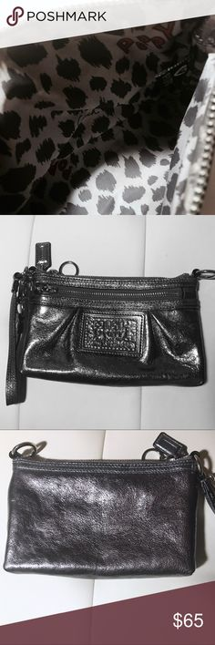 """Coach Poppy Collection Large Leather Wristlet NEW CONDITION/ barely used/ just no tags Metallic Silver Poppy Coach Wristlet. Great for on-the-go essentials; phone, keys, wallet, and a lipstick!  Length: 8"""", Height: 5"""", Depth: 1"""" Cute cheetah and logo patterned lining. Coach Bags Clutches & Wristlets"""