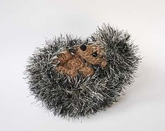 crochet hedgehog, curled in a  ball! looks like a great pattern!