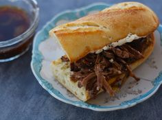 piquant French dip sandwiches ....made in the crock pot!