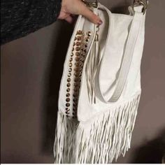 Featured item this week! White stud fringe bag The purpose of a featured item is to get more traffic on items that I think are great pieces and get overlooked! The plus of featuring them for a week: I'll price them as low as possible!! So someone is bound to get a great deal! Bags Satchels