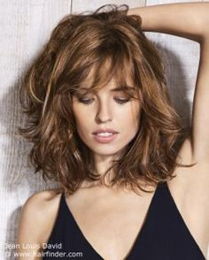 Natural styling for a long brunette bob with layers.