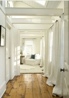 Pretty vintage floors and airy white.