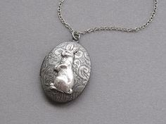 Rabbit locket necklace antiqued silver floral oval by sevenstarz, $23.00