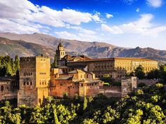 The best way to tour the Alhambra, a palace and fortress complex that dates back to the 13th and 14th centuries in Granada in Spain, is by yourself with a tour guide, or with an audio guide.