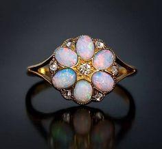 Antique Opal and Diamond Ring c.1900. German. Six cabochon opals, one single cut diamond, and six rose cut diamonds set in yellow gold.