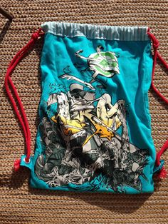 This drawstring backpack, cinch bag is Upcycled from a LRG or Lifted Research Group t shirt and other cotton fabric materials. This is a