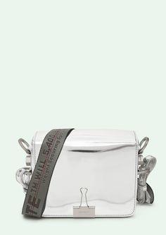 "Cross body leather flap bag in mirror silver with grey ""TIE DOWN"" Industrial belt strap.  Height 17cm. Width 19 cm. Depth 10 cm. Width shoulder strap 7 cm. Length ""TIE DOWN"" shoulder strap 162 cm."