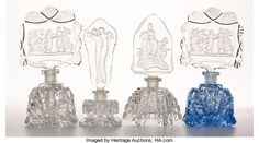 Miscellaneous, FOUR CZECH PERFUME BOTTLES WITH FIGURAL STOPPERS. Circa 1930.Tallest: 7 inches high (17.8 cm). FROM THE ESTATE OF SHIRL...(Total: 4 Items)