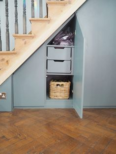 This under stairs storage cupboard was installed in South Tottenham, North London. This unit was manufactured from oak veneer but sprayed in this beautiful grey that shows the oak grain. Under Stairs Drawers, Cabinet Under Stairs, Under Stairs Storage Solutions, Stairway Storage, Cupboard Storage, Shoe Storage, Attic Storage, Alcove Cupboards, Interior Stairs