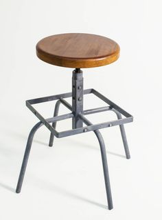 This furniture's industrial style is defined by its solid rivets as well as hand-tarnished and aged steel structure. Trapezoid spindle seat adjustment allows you to adjust the height of this swivel bar stool.