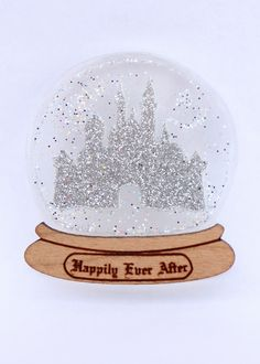 Add a bit of magic and sparkle to your outfit with our Happily Ever After snow globe brooch.