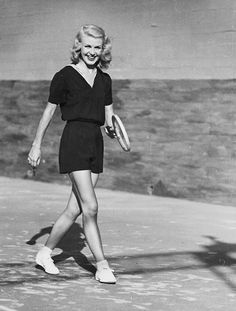 Ginger Rogers photographed while playing tennis, 1930s
