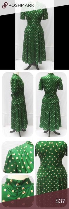 """New Eshakti Retro Fit & Flare Crepe Dress M 8 New Eshakti green floral crepe fit & flare retro style peplum dress. M 8  Measured flat: Underarm to underarm: 35"""" Waist: 29"""" Length: 44"""" Sleeve: 10"""" Eshaki size guide for 8 bust: 36"""" Surplice neck w/ ruched bodice, angled empire waist & button detail. Front split Peplum. Back hidden zipper, attached sash ties to back, side seam pockets.  Lined in polyester moss crepe. Polyester, woven crepe, no stretch. Machine wash. New w/ cut out Eshakti tag…"""