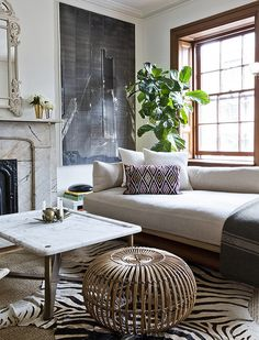 Robert McKinely's Chelsea apartment in T Magazine. Nicole Franzen Photography. Hello Nicole. The table is by the designer, Robert McKinley, himself. You can read more about his work (and home) in this New York Times Style Magazine article and also at his website: Robert McKinley. I hope that helps, G.