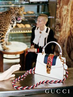 The Gucci Sylvie bag in a new compact shape finished with a top handle and a twisted detachable strap stars in the Spring Summer 2017 campaign.