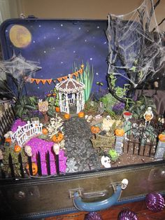 Halloween Fairy Garden in an old suitcase. Added glow in the dark paint to alot of the items so it just glows at night. And there is a set of lights that run along the dirt.