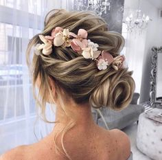 Cute up do. Perfect for a wedding.