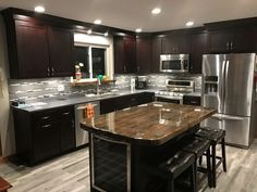 Carriage House Bourbon cabinetry featuring a hand-crafted island top #kitchencabinetskenya
