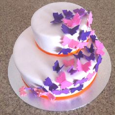 Butterfly cake for 80th party. After a lot of you tube tutorials, hours spent colouring, rolling and punching fondant butterflies, and 2 'trial' cakes, this is the final butterfly cake.
