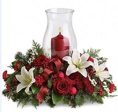 Holiday Glow Centerpiece Flowers - Its beginning to look a lot like Christmas! Add a warm glow to your holiday décor with this lush arrangement of red roses and carnations. Christmas Flower Arrangements, Christmas Table Centerpieces, Christmas Flowers, Christmas Candles, Flower Centerpieces, Xmas Decorations, Floral Arrangements, Christmas Holidays, Christmas Wreaths